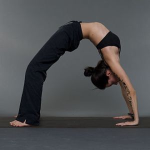 Nina Mel doing the upward facing bow yoga pose